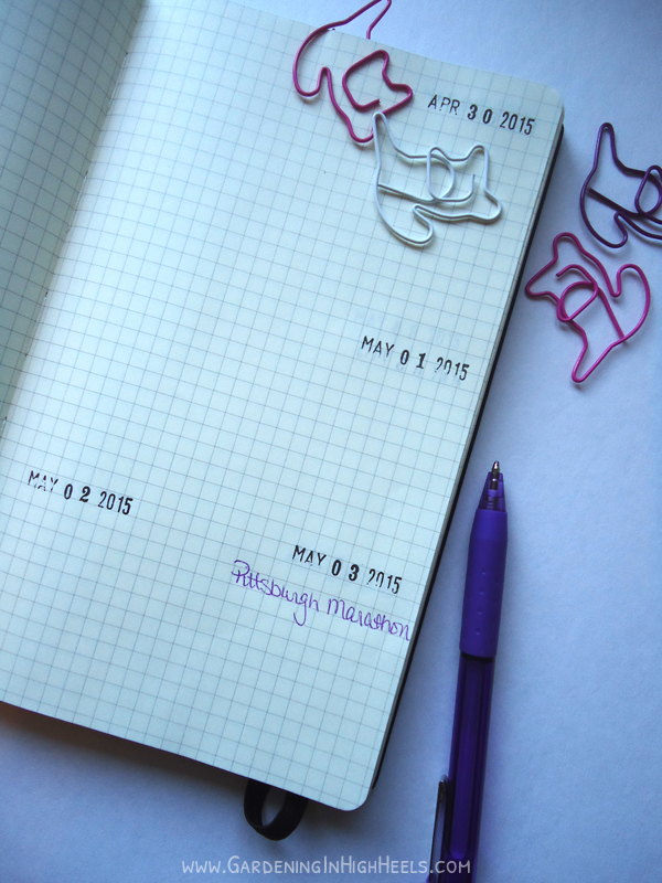 Stamp dates in a Moleskine journal to make a planner