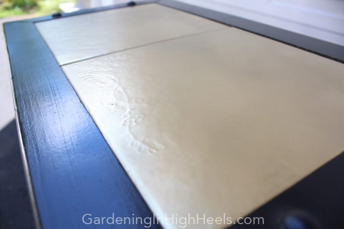 Ceramic tiles spray painted with Rustoleum gold spray paint - perfect DIY update! | Gardening In High Heels