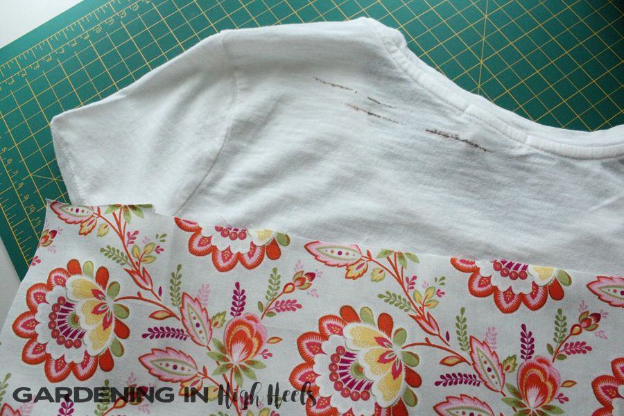"Attempted to up-cycle this shirt and replace the back ""yoke"" area of this shirt with floral fabric"