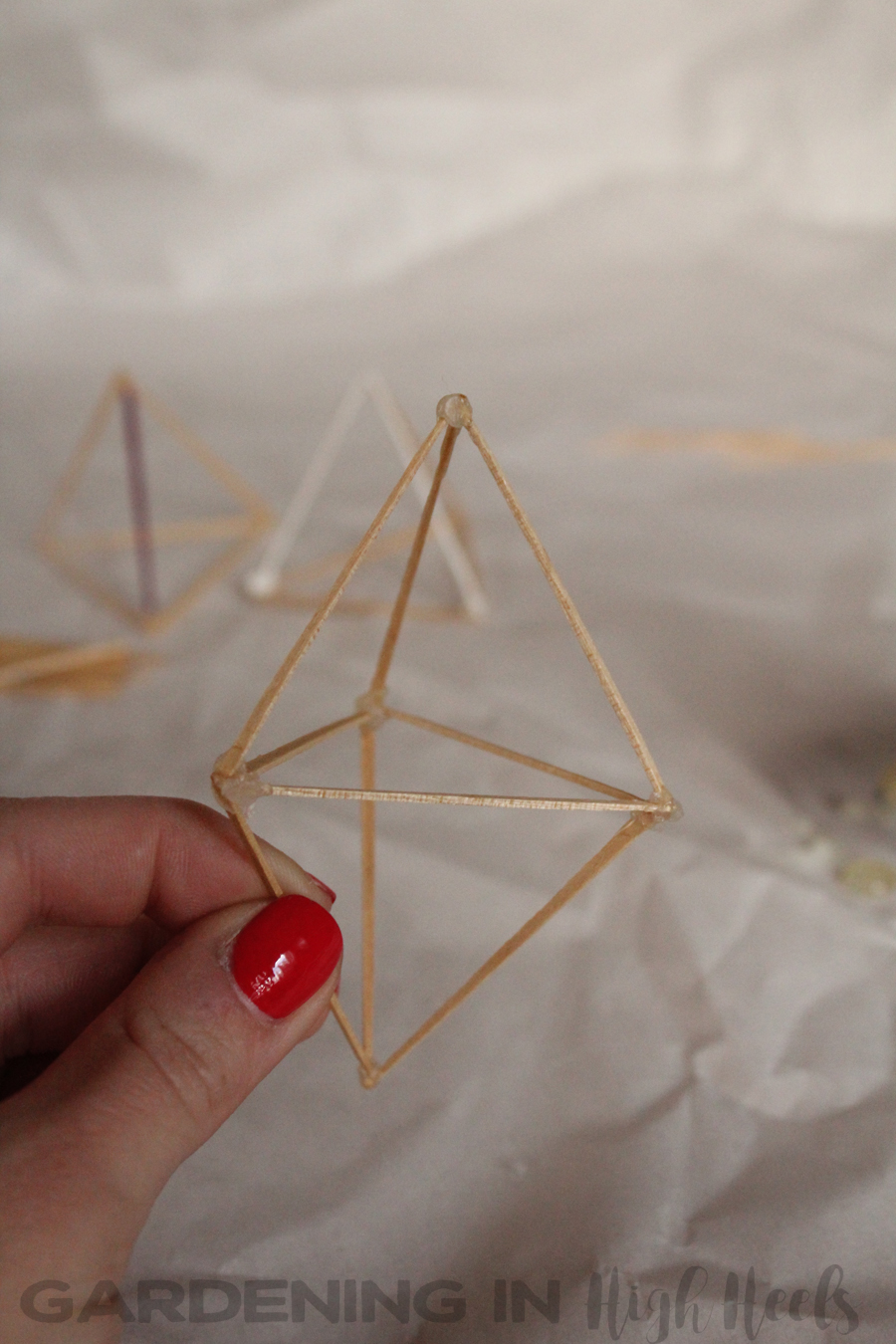 DIY toothpick air plant holder, hanging double pyramid style.